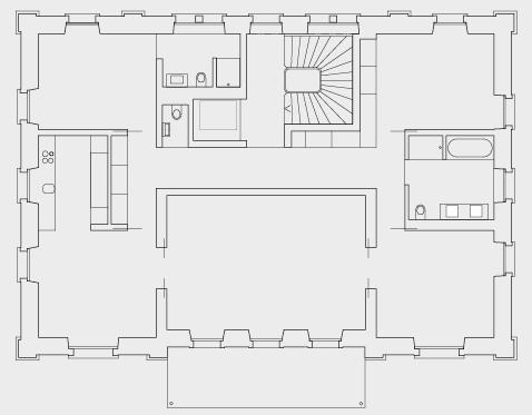 Grundriss mit neuen Wohnungen hinter alten Mauern.